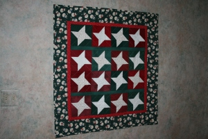 """Christmas Stars"" wall hanging I made a few years ago"