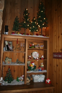 Built in bookcase filled with Christmas knick-knacks