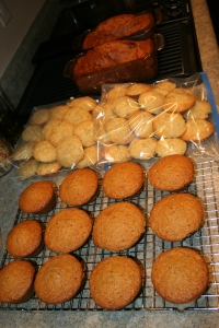 Carrot muffins (still cooling, before frosting), 48 mini banana muffins, two loaves strawberry bread